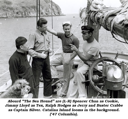 "Aboard ""The Sea Hound"" are (L-R) Spencer Chan as Cookie, Jimmy Lloyd as Tex, Ralph Hodges as Jerry and Buster Crabbe as Captain Silver. Catalina Island looms in the background ('47 Columbia)."
