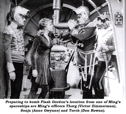 Preparing to bomb Flash Gordon's location from one of Ming's spaceships are Ming's officers Thorg (Victor Zimmerman), Sonja (Anne Gwynne) and Torch (Don Rowan).