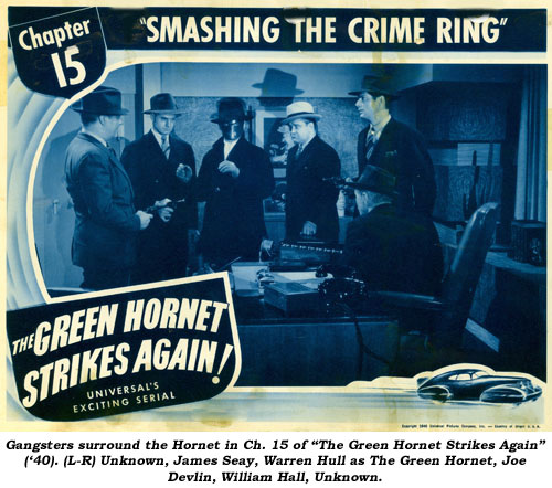 "Gangsters surround the Hornet in Ch. 15 of ""The Green Hornet Strikes Again"" ('40). (L-R) Unknown, James Seay, Warren Hull as The Green Hornet, Joe Devlin, William Hall, Unknown."