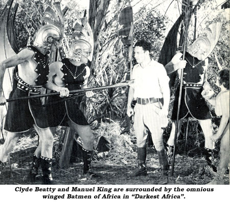 "Clyde Beatty and Manuel King are surrounded by the omnious winged Batmen of Africa in ""Darkest Africa""."