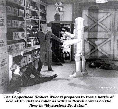 "The Copperhead (Robert Wilcox) prepares to toss a bottle of acid at Dr. Satan's robot as William Newell cowers on the floor in ""Mysterious Dr. Satan""."