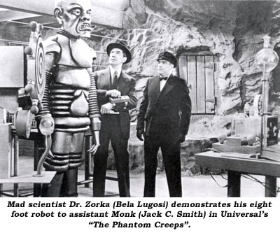 "Mad scientist Dr. Zorka (Bela Lugosi) demonstrates his eight foot robot to assistant Monk (Jack C. Smith) in Universal's ""The Phantom Creeps""."