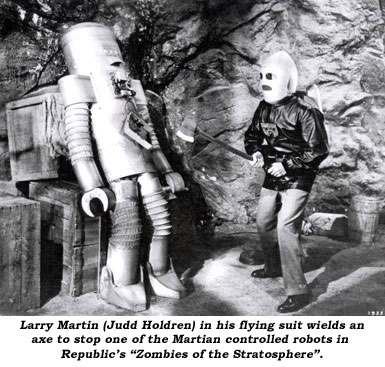 "Larry Martin (Judd Holdren) in his flying suit wields an axe to stop one of the Martian controlled robots in Republic's ""Zombies of the Stratosphere""."
