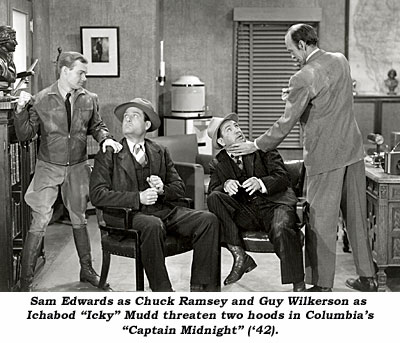 "San Edwards as Chuck Ramseu and Guy Wilkerson as Ichabod ""Icky"" Mudd threaten two hoods in Columbia's ""Captain Midnight"" ('42)."