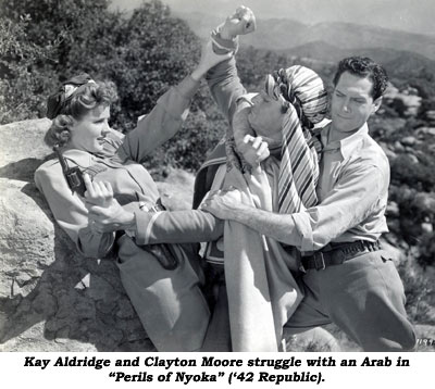 "Kay Aldridge and Clayton Moore struggle with an Arab in ""Perils of Nyoka"" ('42 Republic)."
