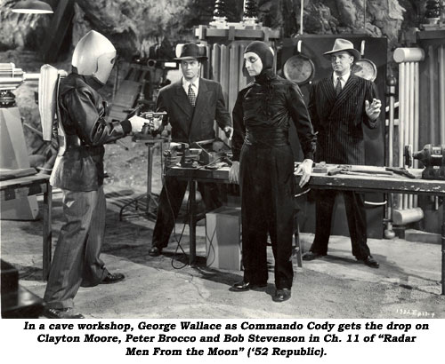 "in a cave workshop, George Wallace as Commando Cody gets the drop on Clayton Moore, Peter Brocco and Bob Stevenson in Ch. 11 of ""Radar Men From the Moon"" ('52 Republic)."