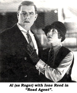 "Al (as Roger) with Ione Reed in ""Road Agent""."