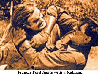 "Francis Ford fights with a badman in a scene from ""Another Man's Boots""."