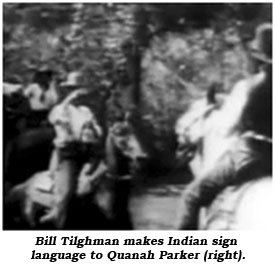 Bill Tilghman makes Indian sign language to Quanah Parker (right).