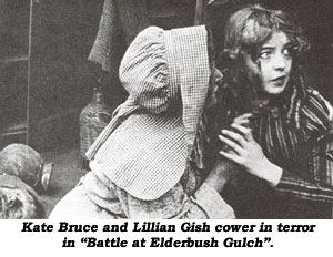 "Kate Bruce and Lillian Gish cower in terror in ""Battle at Elderbush Gulch""."