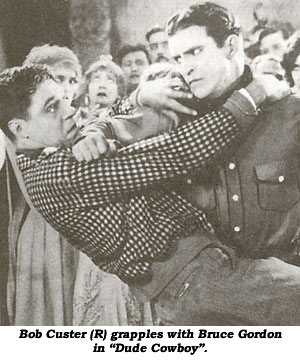 "Bob Custer (R) grapples with Bruce Gordon in ""Dude Cowboy""."