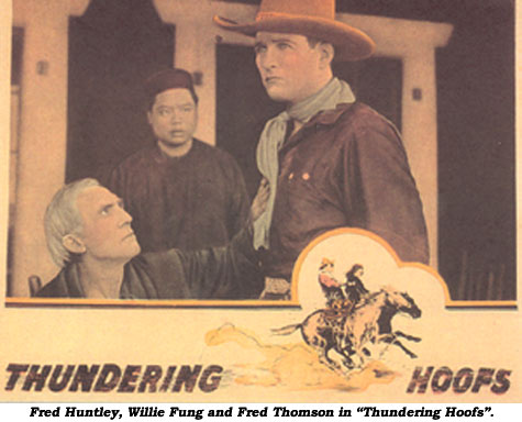 "Fred Huntley, Willie Fung and Fred Thomson in ""Thundering Hoofs""."