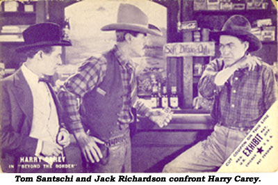 "Tom Santschi and Jack Richardson confront Harry Carey in the arcade card scene photo from ""Beyond the Border""."