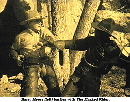 Harry Meyers (left) battles with The Masked Rider.