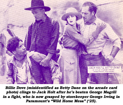 "Billie Dove (misidentified as Betty Dane on the arcade card photo) clings to Jack Holt after he's beaten George Magrill in a fight, who is now grasped by storekeeper George Irving in Paramount's ""Wild Horse Mesa"" ('25)."
