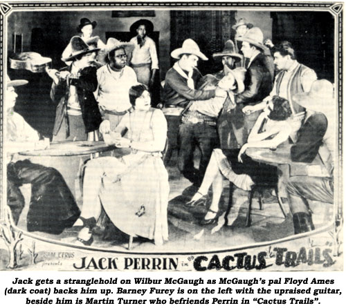 "Jack gets a stranglehold on Wilbur McGaugh as McGaugh's pal Floyd Ames (dark coat) backs him up. Barney Fure is on the left with the upraised guitar, beside him is Martin Turner who befriends Perrin in ""Cactus Trails""."