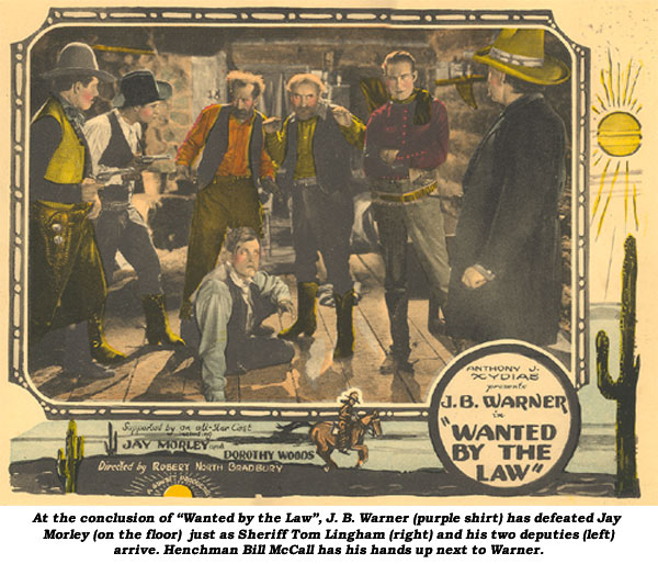 "At the conclusion of ""Wanted by the Law"", J. B. Warner (purple shirt) has defeated Jay Marley (on the floor) just as Sheriff Tom Lingham (right) and his two deputies (left) arrive. Henchman Bill McCall has his hands up next to Warner."