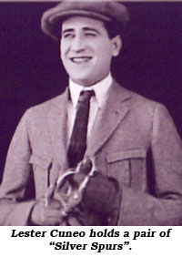 "Lester Cuneo holds a pair of ""Silver Spurs""."