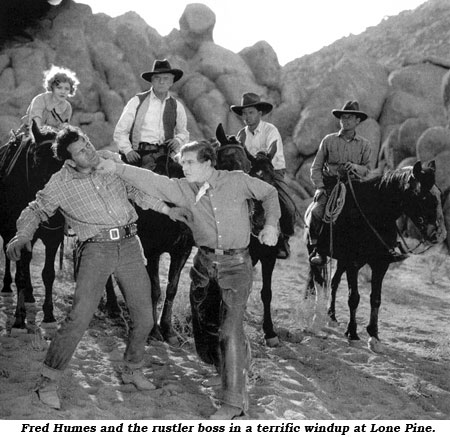 Fred Humes and the rustler boss in a terrific windup at Lone Pine.