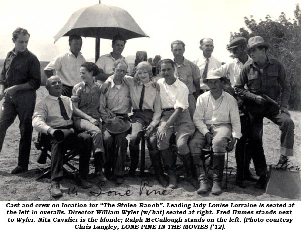 "Cast and crew on location for ""The Stolen Ranch"". Leading lady Louise Lorraine is seated at the left in overalls. Director William Wyler (w/hat) seated at right. Fred Humes stands next to Wyler. Nita Cavalier is the blonde; Ralph McCullough stands on the left. (Photo courtesy Chris Landley, LONE PINE IN THE MOVIES ('12)."