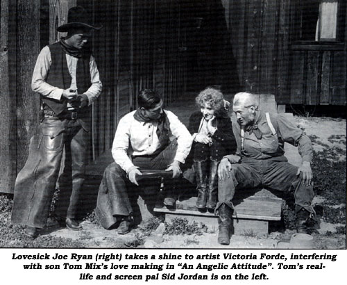 "Lovesick Joe Ryan (right) takes a shine to artist Victoria Forde, interfering with son Tom Mix's love making in ""An Angelic Attitude"". Tom's real life and screen pal Sid Jordan is on the left."