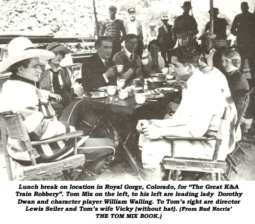 "Lunch break on location in Royal Gorge, Colorado, for ""The Great K&A Train Robbery"". Tom Mix on the left, to his left are leading lady Dorothy Dwan and character player William Walling. To Tom's right are director Lewis Seiler and Tom's wife Vicky (without hat). (From Bud Norris' THE TOM MIX BOOK.)"