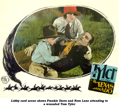 Lobby card scene shows Frankie Darro and Nora Lane attending to a wounded Tom Tyler