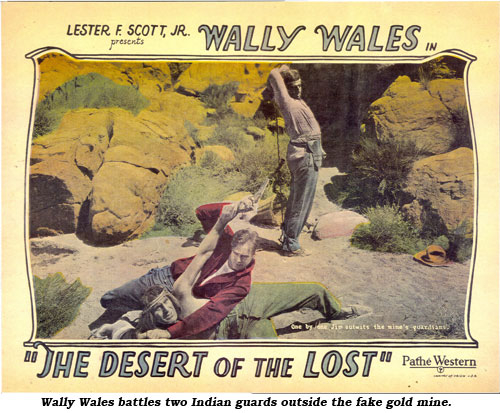 Wally Wales battles two Indian guards outside the fake gold mine.