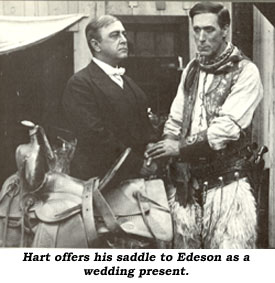 Hart offers his saddle to Edeson as a wedding present.