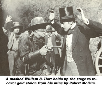 A masked William S. Hart holds up the stage to recover gold stolen from his mine by Robert McKim.