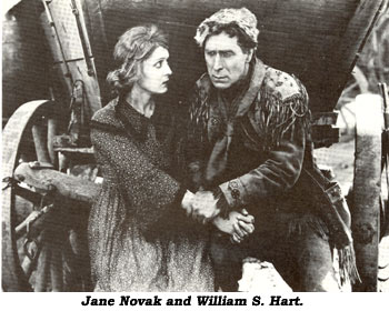 "Jane Novak and William S. Hart in ""Wagon Tracks""."