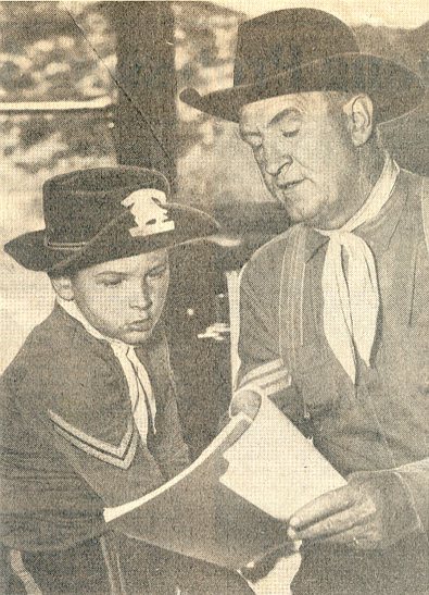 "Joe Sawyer as Sgt. Bill O'Hara on TV's ""Rin Tin Tin"" with his son, Riley Sauers"