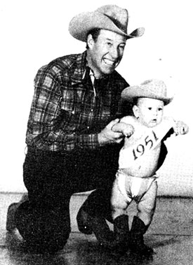 Bill Elliott was in Cisco, TX, just before Christmas 1950 to represent BACK IN THE SADDLE horseman magazine in thier annual Christmas parade. While in Cisco Bill posed for the above two pictures with 14 month old Bonnie Jo Steffen, editor Randy Steffen's daughter. The photo on the left was used for the cover of BACK IN THE SADDLE (1/51) and the other was used in the interior of the magazine. The photo below was taken in the offices of BACK IN THE SADDLE.