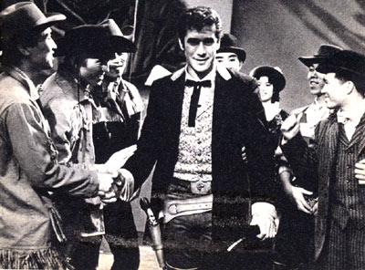 "Robert Fuller, star of TV's ""Laramie"", was greeted by some 5,000 Japanese fans in April of '61 when he appeared in Japan at the invite of the president of the Pacific Television Corporation and self appointed head of the Bob Fuller Fan Club, Japanese division. Fuller visited six cities in 22 days. In Osaka police estimated the crowd at 500,000. Bob had tea with the Prime Minister and his wife, was photographed with one of the Emperor's favorite horses, had a friendly Judo bout with one of Japan's top experts and staged a two-hour TV variety show as a benefit for Japanese orphanages. Bob was presented with the Golden Order of Merit by a personal representative of the Empress. While in Japan he received over 1,000 gifts from fans."