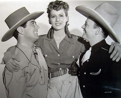 "Johnny Mack Brown and Bob Baker give a lift to their ""Riders of Pasco Basin"" leading lady Frances Robinson. (Thanx to Bobby Copeland.)"