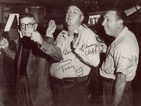 A local look-alike for the great stoneface, comedian Buster Keaton, and the real Frog, Smiley Burnette, do a little clowning around with THE CLARION LEDGER photographer, Cliff Bingham, in Jackson, MS. (Thanx to Danny Brown and Marjorie Bowron.)