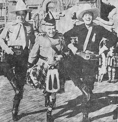 In Albuquerque, NM, for the annual Route 66 Convention in March 1939, Monte Blue (left) and Charles Starrett (right) indulbed in a little impromtu Highland Fling before startled but amused crowds.