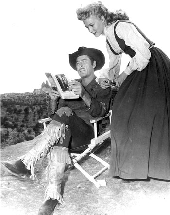 "Errol Flynn and Patrice Wymore take a break while filming ""Rocky Mountain"" ('50 WB) in Gallup, NM. Flynn and Wymore met during the shoot and were later married. (Photo courtesy Neil Summers.)"