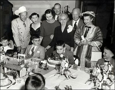 Roy Rogers and Dale Evans help Mamie Eisenhower (next to Roy), Barbara and John Eisenhower (son and daughter-in-law of the president), unknown relative?, and President Dwight D. Eisenhower celebrate grandson David's birthday at the White House in 1956. (Photo courtesy Jerry Dean.