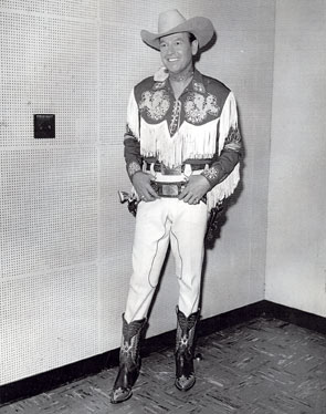 "The Arizona Cowboy, Rex Allen, waits backstage at NBC where he was set to appear on ""The Lux Show Starring Rosemary Clooney"" which aired between September 26, 1957, and June 19, 1958."