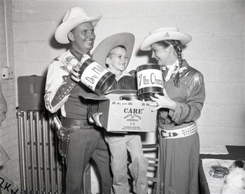 "Gene Autry, Gail ""Annie Oakley"" Davis and five year old Mark Ryan help promote C.A.R.E. in 1956 Chicago. (Thanx to Roy Bonario.)"