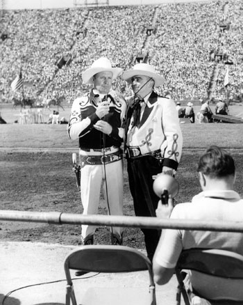 Gene with Sheriff Eugene Biscailuz at the L.A. Coliseum for the annual Sheriff's Championship Rodeo in 1954.