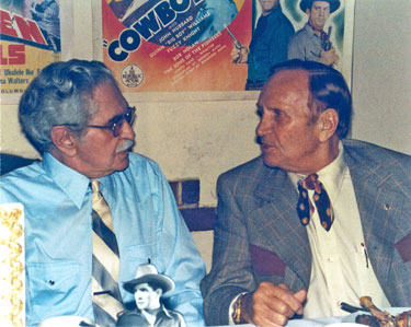 Gene talks with Bob Steele as Steele is honored by the Masquers Club on  November 20, 1982.