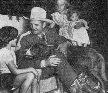 Denise Dennem, 6, (left) of Chicago tells Gene all about her dog Patches while Elizabeth Langdon, 8, waits to present her doll to Gene. Photo taken during a Name Champion's Colt contest sponsored by the CHICAGO SUN-TIMES in 1948.