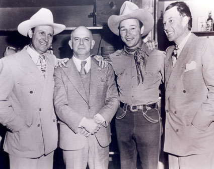 Republic head Herbert J. Yates with his three biggest cowboy stars, Gene, Roy Rogers  and Bill Elliott.