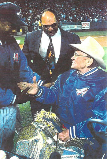 Former Angels players Rod Carew ('79-'85) and Reggie Jackson ('82-'86) offer congratulations to Angels owner Gene Autry on opening day April 8, 1998. (Photo courtesy Billy Holcomb.)