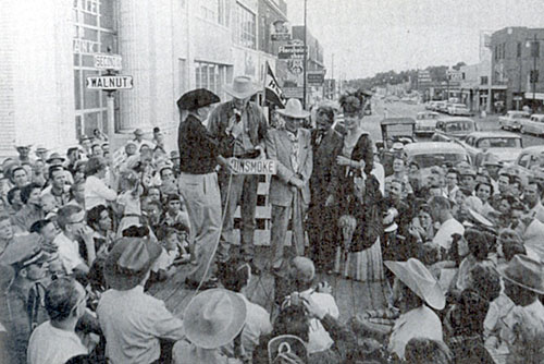 James Arness, Milburn Stone and Amanda Blake help rename Walnut Street to Gunsmoke in Dodge City, Kansas, 1958.