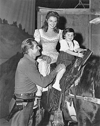 "Jock Mahoney with co-star Luana Patten and her sister Marcy on Jock's horse on the set of ""Joe Dakota"" ('57 U-I). (Photo courtesy Roy Bonario.)"