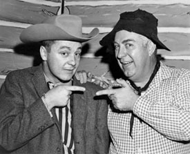 "Smiley Burnette visits John Garner, host of the Port Arthur, TX kids show ""Circle 4 Ranch"" on KPAC-TV Channel 4 in Port Arthur. 10/2/62. (Photo courtesy Roy Bonario.)"