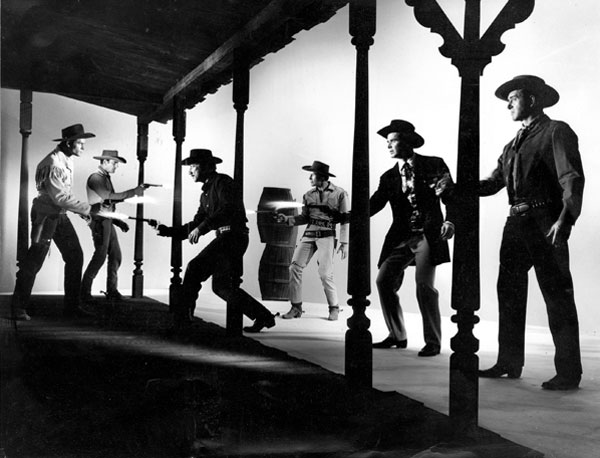 "Talk about a gathering of guns! Magnificent TV Western round-up with (L-R) Clint Walker (""Cheyenne""), James Arness (""Gunsmoke""), Richard Boone (""Have Gun Will Travel""), Robert Horton (""Wagon Train""), James Garner (""Maverick""), John Payne (""Restless Gun"")."